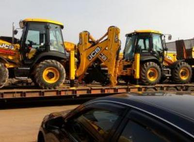 Перевозка тракторов – причины довериться профессионалам