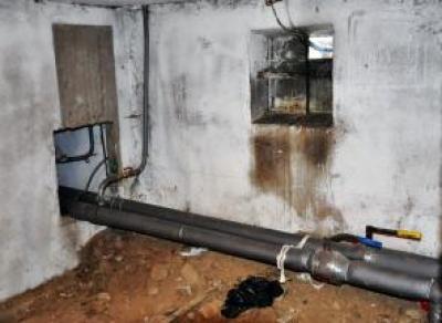 Коммунальщики  нашли останки  человека в подвале  жилого дома